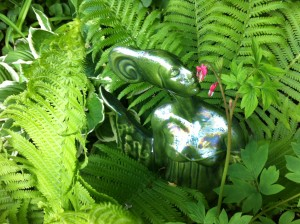 My Green Lady among ferns, enjoying the blossoms of the bleeding heart!
